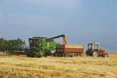 Combineer en tractor Stock Afbeeldingen
