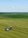 Combineer het gras van machinebesnoeiingen Stock Foto