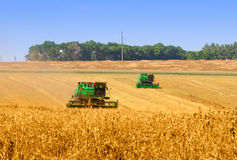 Combines working on a wheat field Royalty Free Stock Photo