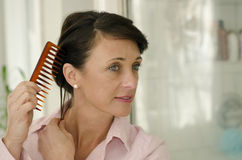 Combing Royalty Free Stock Image