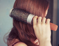 Combing hair Stock Images