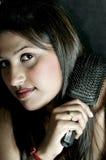 Combing hair royalty free stock photos