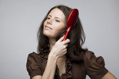 Combing hair. Stock Photo