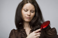 Combing hair. Stock Images