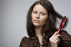 Combing hair. Royalty Free Stock Image
