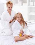 Combing hair after bath Stock Photo