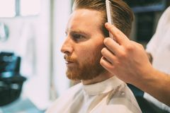 Combing of hair and styling royalty free stock photo