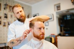 Combing of hair and styling stock images