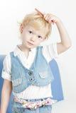 Combing little girl Stock Photo