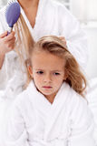 Combing and pulling hair - the price of  beauty Royalty Free Stock Photo