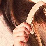 Combing and pulls hair. Royalty Free Stock Photo