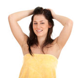 Combing young woman in yellow towel Royalty Free Stock Photo