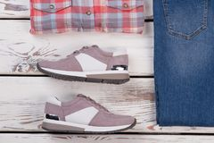 Combining women`s sneakers with clothes Royalty Free Stock Photos
