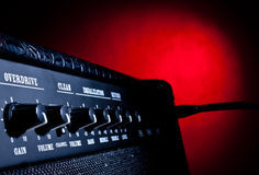 Combo amplifier on red background. Combo amplifier closeup on red background royalty free stock image