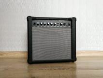 Guitar combo amplifier on the wooden floor. Combo amplifier and sound speaker for guitar on the wooden floor royalty free stock image