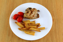 Combo dish. Chicken combo dish with fried potatoes and tomatoes Stock Photo