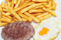 Combo platter with fried egg, burger and french fries Royalty Free Stock Photography