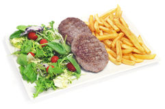 Combo platter with fried salad, burgers and french fries Royalty Free Stock Images