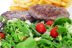 Combo platter with salad, burger and french fries Stock Image
