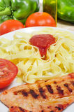 Combo platter with tagliatelle and chicken Stock Photo