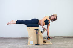 Combo wunda pilates chair woman fitness yoga gym Stock Photography