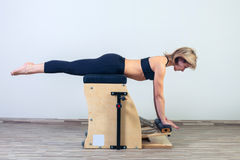 Combo wunda pilates chair woman fitness yoga gym Royalty Free Stock Images