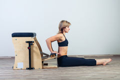Combo wunda pilates chair woman fitness yoga gym Royalty Free Stock Photography