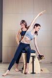Combo wunda pilates chair woman with instructor Stock Photos