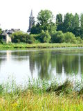 Combourg ( France ). View of Combourg church from the pond Stock Photo