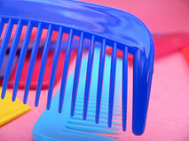 Combs. On Pink Stock Image