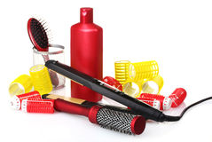 Combs, curling iron and hair curlers Stock Photography