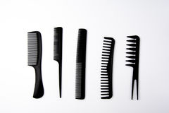 Combs. Different types of combs on white background Stock Images