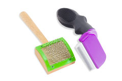 Combs for grooming of the cats hair Royalty Free Stock Images