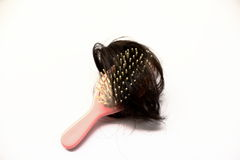 Combs and Hair. Black hair tumbled attached to the whistle Stock Photos