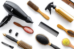 Combs and hairdresser tools in beauty salon on white background top view Royalty Free Stock Photography