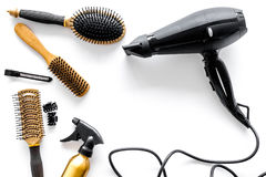 Combs and hairdresser tools in beauty salon on white background top view copyspace. Combs and hairdresser tools in beauty salon on white background top view Royalty Free Stock Images