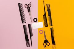 Combs and hairdresser tools on color background top view royalty free stock photos