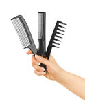 Combs in her hand Stock Photography