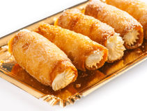 Combs and honey pastry filled with cream Stock Photos