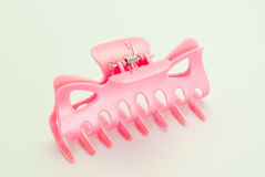 Combs pink is placed on a white background. Royalty Free Stock Photography