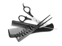 Combs and scissor. On a white Stock Images