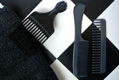 Combs set. Black combs set on white and black background Royalty Free Stock Photography