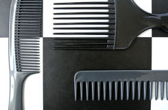 Combs set. Black combs set on white and black background Royalty Free Stock Photos