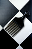 Combs set. Black combs set on white and black background Royalty Free Stock Images