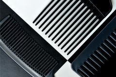 Combs set. Black combs set on white and black background Royalty Free Stock Photo