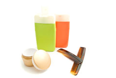 Combs, shampoo and other toiletry. On white Stock Image