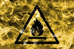 Combustible and flammable materials hazard warning smoke sign. T. Riangular warning hazard sign, smoke background stock images