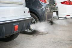 Combustion fumes coming out of car exhaust pipe.  royalty free stock photo