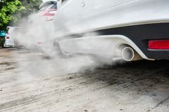 Free Combustion Fumes Coming Out Of White Car Exhaust Pipe, Air Pollution Concept Royalty Free Stock Photography - 111684737