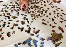 Começar reunir um enigma de serra de vaivém Foto de Stock Royalty Free